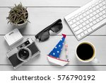 old camera with sunglasses and... | Shutterstock . vector #576790192