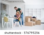 young couple moving in a new...   Shutterstock . vector #576795256