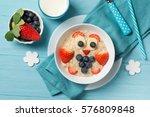 funny oat porridge with owl... | Shutterstock . vector #576809848