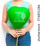 girl holding a happy birthday... | Shutterstock . vector #576831286