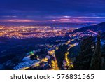 Night scenic view at cityscape of town Split and suburb from upper hills in background, Croatia, european travel places. / Selective focus, long exposure,  intentional underexposed areas. - stock photo