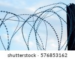 barbed wire on fence | Shutterstock . vector #576853162