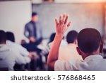student sitting at their desks  ... | Shutterstock . vector #576868465