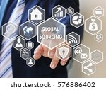 Stock photo the businessman clicks the button global sourcing on the touch screen 576886402