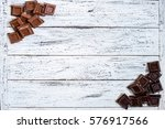 milk and black chocolate pieces ... | Shutterstock . vector #576917566