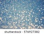 blurred glittering lights blue...   Shutterstock . vector #576927382