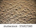 close up photo of wet sea sand... | Shutterstock . vector #576927385