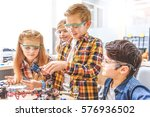 curios young technicians... | Shutterstock . vector #576936502