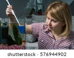 Young Woman Cleaning Aquarium...