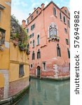 canal with colorful facades of...