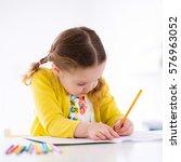 cute little girl doing homework ...   Shutterstock . vector #576963052