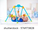 cute baby boy on colorful... | Shutterstock . vector #576973828