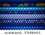 stack of fabric blue cloth rolls | Shutterstock . vector #576984415