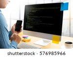 """developer team working laptop... | Shutterstock . vector #576985966"