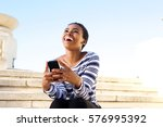 portrait of happy young woman...   Shutterstock . vector #576995392
