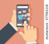 men on the screen. hand holding ... | Shutterstock . vector #577001218