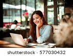 asian woman using laptop in... | Shutterstock . vector #577030432