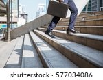 Small photo of Businessman running fast upstairs. Horizontal outdoors shot.