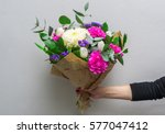 Woman Hand Holding Flowers....