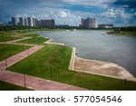 artificial pond on outskirts of ... | Shutterstock . vector #577054546