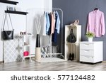 fashionable clothes hanging on... | Shutterstock . vector #577124482