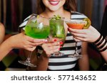 girls with cocktails toasting... | Shutterstock . vector #577143652