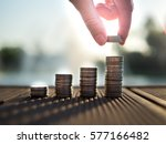 hand putting money coins stack... | Shutterstock . vector #577166482