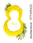 Small photo of Greeting Card International Women's Day on March 8th. Branches of mimosa in the form of number eight