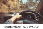 man driving a car on holiday... | Shutterstock . vector #577196212