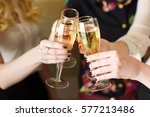 hands holding the glasses of... | Shutterstock . vector #577213486