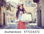fashionably dressed woman on... | Shutterstock . vector #577214272