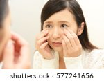 young woman having skin problems | Shutterstock . vector #577241656