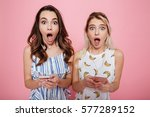 two surprised astonished young... | Shutterstock . vector #577289152