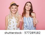 two smiling cute girls standing ... | Shutterstock . vector #577289182