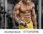 muscular man working out in gym ... | Shutterstock . vector #577293598