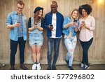 group of good looking young... | Shutterstock . vector #577296802