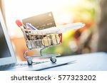small shopping cart contains... | Shutterstock . vector #577323202