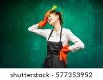 tired girl in gloves.a headache ... | Shutterstock . vector #577353952
