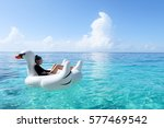 sexy girl on white swan... | Shutterstock . vector #577469542