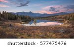 mirror surface lake early... | Shutterstock . vector #577475476