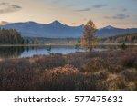 mirror surface lake autumn... | Shutterstock . vector #577475632