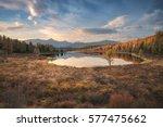 mirror surface lake autumn... | Shutterstock . vector #577475662