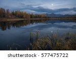 mirror surface lake autumn... | Shutterstock . vector #577475722