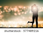 silhouette of kissing couple... | Shutterstock . vector #577489216