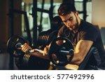 handsome man doing biceps... | Shutterstock . vector #577492996