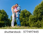 mother  father  child  holding... | Shutterstock . vector #577497445
