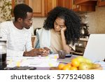 young african family facing... | Shutterstock . vector #577524088