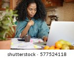 serious and concentrated young... | Shutterstock . vector #577524118