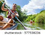 young people canoeing | Shutterstock . vector #577538236