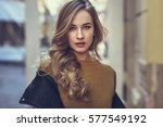 blonde woman in urban... | Shutterstock . vector #577549192